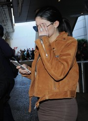 Kylie Jenner was spotted at LAX sporting her rumored engagement ring.