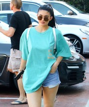 Kylie Jenner kept the sun out with a pair of brown shades by Elizabeth and James while shopping in Malibu.
