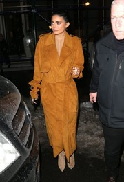 Kylie Jenner looked tough-glam in an orange suede trenchcoat while grabbing dinner at Nobu.