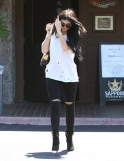 Kylie Jenner went rugged in a torn white tee by IRO for a lunch out.