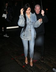 Kylie Jenner matched her jacket with a pair of ripped skinny jeans by AGOLDE.