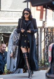 Kylie Jenner added more oomph with a pair of over-the-knee lace-up boots by Tom Ford.