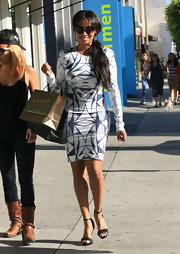 La La Anthony turned heads on the streets of West Hollywood in a curve-hugging geometric-print dress.