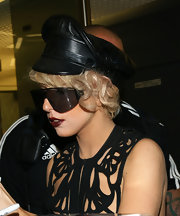 Lady Gaga topped off her stylish attire with a leather captains hat.