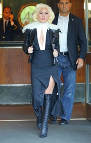 Lady Gaga stepped out of her apartment looking super chic in a black-and-white dress with a high, ruffled neckline, a button-up bodice and a thigh-baring slit.
