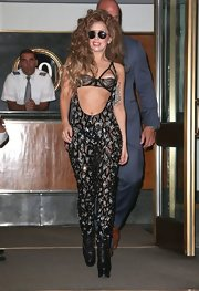 Lady Gaga's beaded jumpsuit revealed just a peek of midriff for a sexy glammed up look.