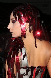 Lady Gaga looked flamboyant, as always, wearing this sequined red headdress while out in New York City.