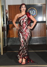Lady Gaga commanded stares when she stepped out in New York City wearing this one-shoulder gown featuring red embellishments that looked like streaks of blood.
