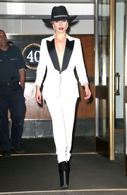 Lady Gaga headed out in New York City wearing a sleek and chic satin-lapel pantsuit by Tom Ford.