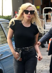Lady Gaga teamed a studded black belt with a tight tee and jeans for a day out in New York City.