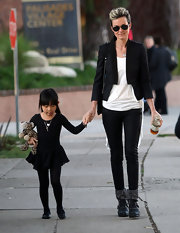 Laeticia donned a black tux stye blazer for a walk with her daughter.