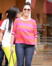 La La Anthony topped off her casual look with a fun pair of square pink sunnies while out shopping in Miami.