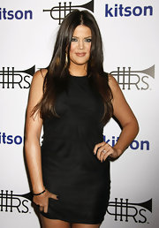 Khloe rocks her classic center part to the launch of her husbands fashion line.