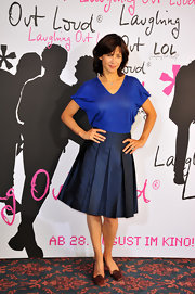 Sophie Marceau's pleated knee length skirt popped with personality.