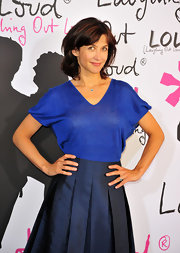 Sophie Marceau's knit top was casual but still really cute tucked into a structured pleated skirt.