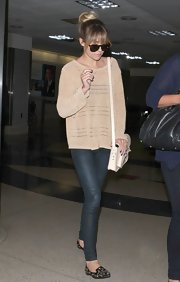 LC wore a pair of dark-wash skinny jeans to balance out her oversized sweater.