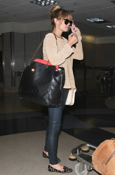 Lauren Conrad in a beige sweater and skinnies.