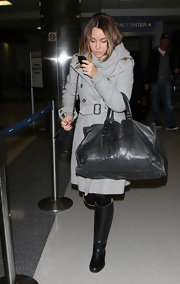 Lauren Conrad donned sleek black knee high boots at LAX. The chic footwear completed Lauren's polished travel attire.