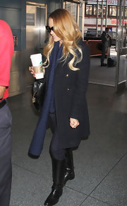 Lauren Conrad kept it classic for her train ride in these black leather knee-high boots.
