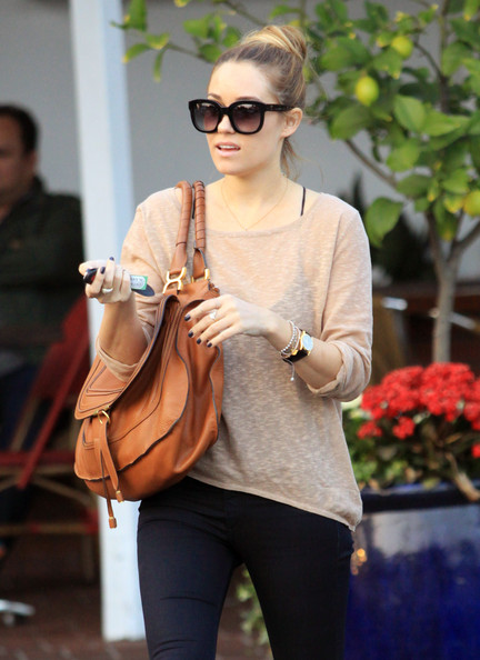 Lauren Conrad kept her look casual yet polished by wearing her hair in a stylish loose bun while out in LA.