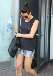 Lea is wearing Lanston nautical striped shorts with slanted pockets and a braided rope tie.