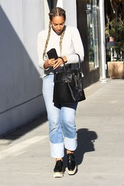 Leona Lewis chose a pair of faded boyfriend jeans to team with her top.