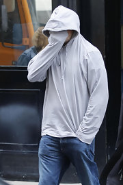Though it wouldn't land him on the best-dressed list, this gray hoodie served Leonardo DiCaprio well as he left his hotel in Paris.