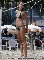 Leticia showers off while wearing a green halter-top bikini.