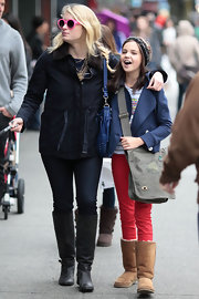 Bailee Madison carried a large messenger bag as she walked in the streets of Vancouver.