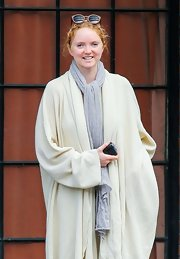 Lily Cole was all covered up in a gray knit scarf and an oversized cardigan while waiting for a cab in Manhattan.