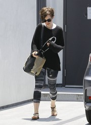 For her footwear, Lily Collins chose a pair of studded thong sandals.