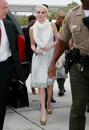 Lindsay Lohan showed up to court in LA in a demure fit and flare dress paired with metallic gold peep-toe pumps.