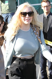 A smiley Lindsay Lohan exited the courtroom in a pair of retro tortoiseshell shades.