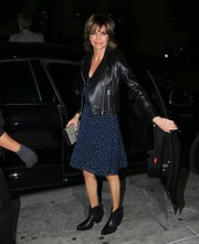 Lisa Rinna's black leather biker jacket made an edgy contrast to her cute frock.