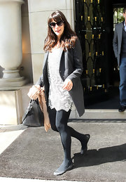 Liv Tyler paired her lacy crocheted dress with a pair of opaque black tights and simple leather ballet flats.