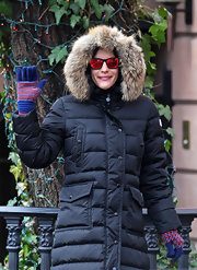 Liv Tyler showed off a quirky look in orange reflective sunglasses.
