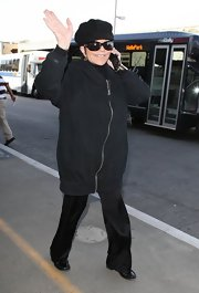 Liza Minnelli kept herself warm with a fleece jacket while waiting for her flight at the LAX.