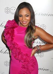 Ashanti paired her hot pink dress with colorful bangle bracelets in assorted gemstones.