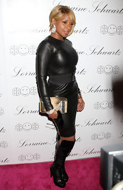 Leave it to Mary J. to rock a long sleeve leather dress and knee high leather boots.