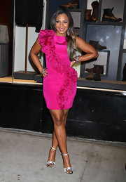 Ashanti loves bold and bright colors. Here she rocks a hot pink cocktail dress with a beautiful textured detail that wraps the dress.