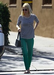 "January Jones was out and about in Los Angeles wearing a pair of mid-rise ankle length skinny jeans in the shade ""wheat grass."""