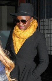 Lupita Nyong'o brightened up her coat with a yellow knit scarf while out and about in New York City.