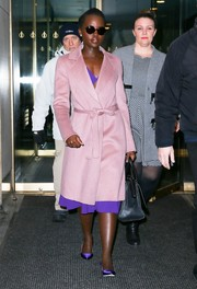 Lupita Nyong'o stole the show in her lilac Escada wrap coat that covered her cutaway Michael Kors purple dress. The Star Wars actress finished her head-to-toe plum look with SJP by Sarah Jessica Parker heels.