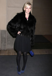 Socialite Lydia Heart blocked out the cold in a dark brown fur coat.