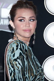 Miley Cyrus wore a pair of bold gemstone earrings at the 28th Annual MTV Video Music Awards. The organic shape of the jewelry reflected the natural prints on her gown.