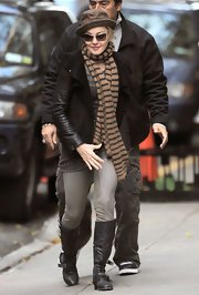 Madonna stayed casual in buckled flat boots. She paired the leather boots with a matching leather jacket.