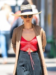 Maggie Q took a walk in New York City looking summery in a straw hat.