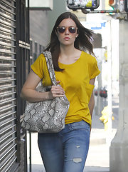 Mandy Moore brightened the cityscape in a marigold T-shirt.