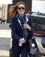 Marcia Cross's amber hued sunglasses complement her signature red locks.