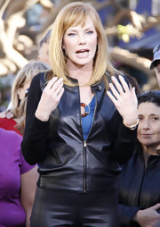 Marg Helgenberger sizzled on 'Extra' in a fitted leather jacket with contrasting fabric sleeves.
